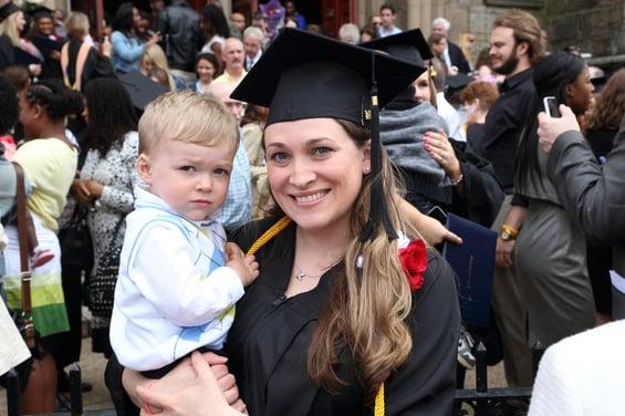 Graduation, woman with child