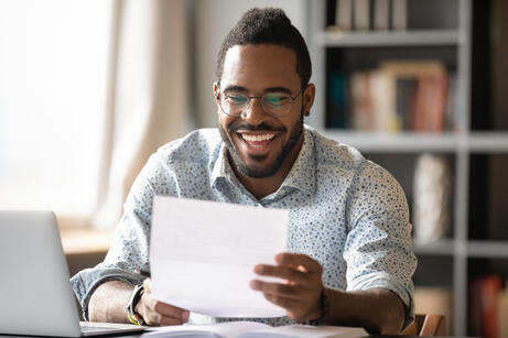 Cheerful-african-american-male-entrepreneur-read-great-news-in-letter-1203044172_6720x4480