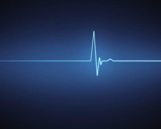 Blue ECG heartbeat on black background
