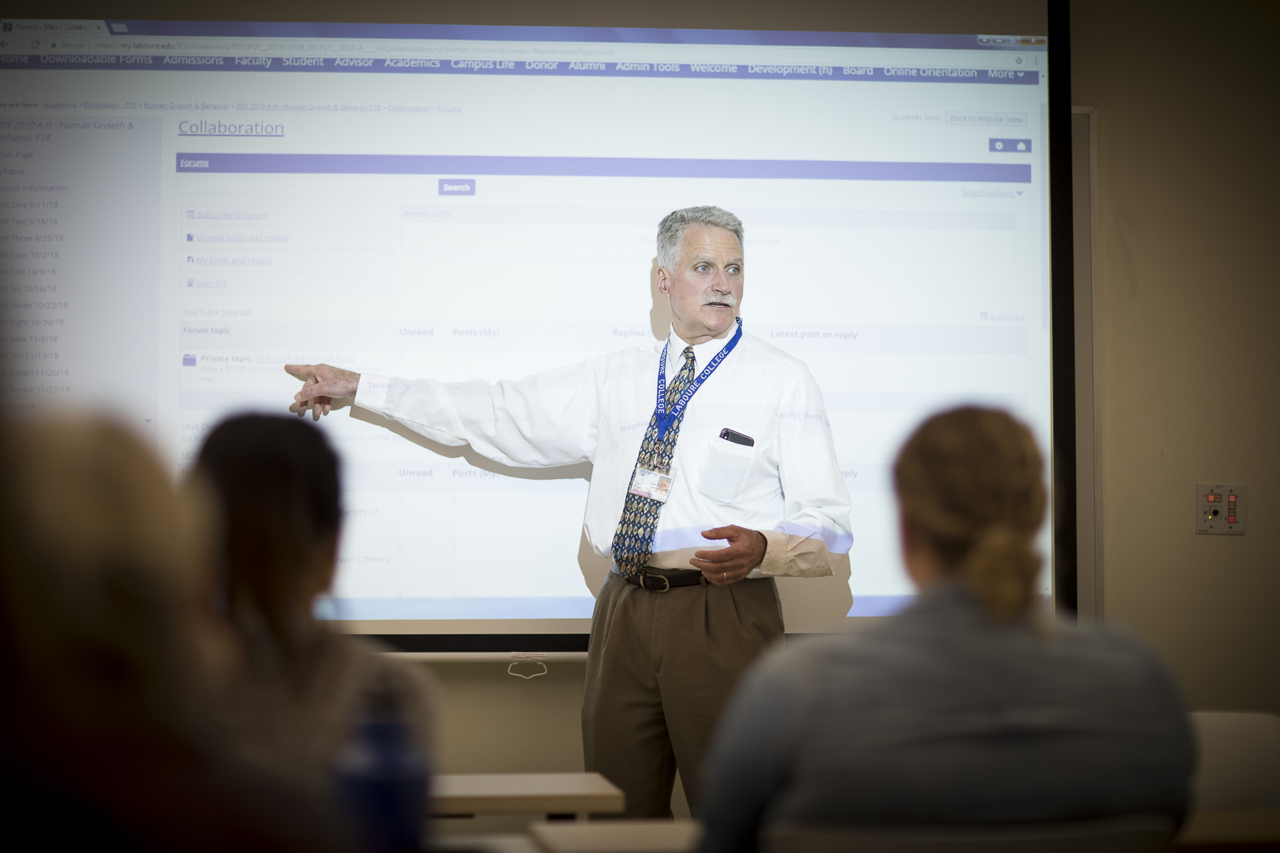 Instructor teaches with projector